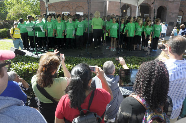 "It was Connecticut Day at the Eastern States Exposition, or ""Big E,"" Wednesday. Children from the Wintergreen Interdistrict Magnet School, out of Hamden, perform a series of songs in front of the Connecticut building."