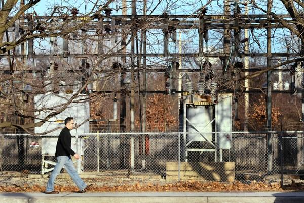 A man walks by a Com-Ed electrical site in Barrington on Tuesday, March 6, 2012.