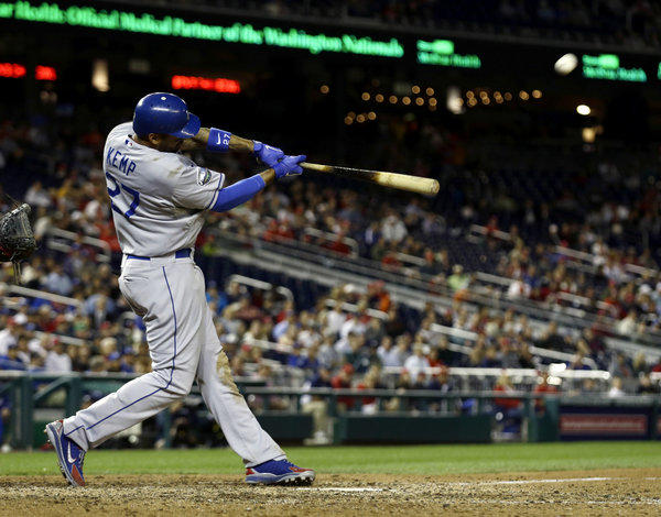Matt Kemp hits a solo homer in the ninth inning of the Dodgers' victory over Washington on Wednesday.