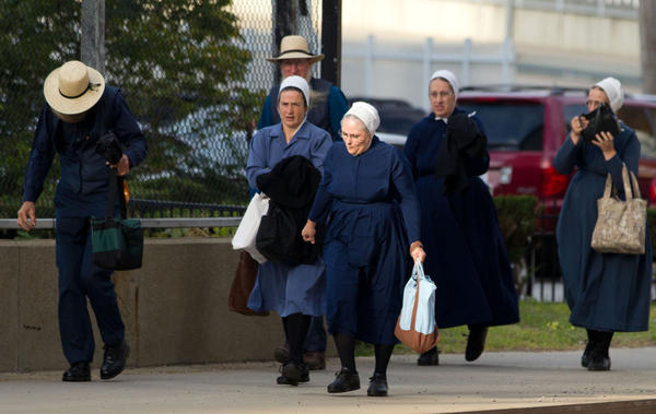 A group of Amish walk to the U.S. Federal Courthouse in Cleveland on Thursday.  The jury will begin their fifth day of deliberations in the trial of 16 Amish people accused of hate crimes in hair- and beard-cutting attacks against fellow Amish in Ohio.