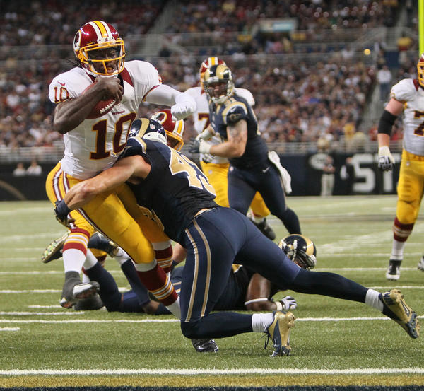 Washington quarterback Robert Griffin III scores on a seven-yard touchdown run against the St. Louis Rams.