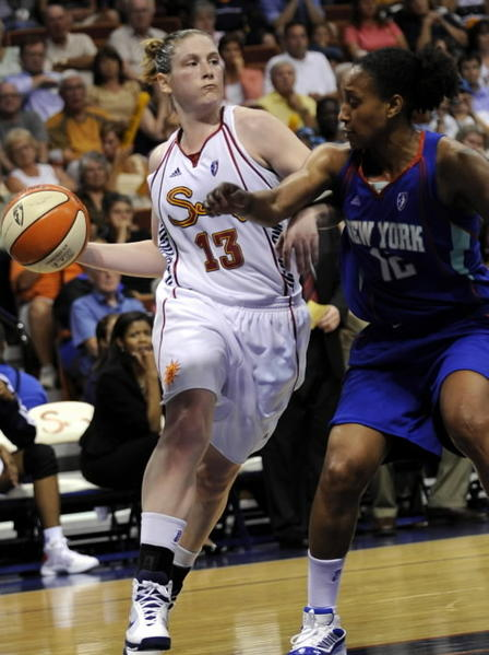 Lindsay Whalen, now with the Minnesota Lynx, drives against New York Liberty's Loree Moore during the second half of a WNBA basketball game in Uncasville Aug. 19, 2009. The Sun won 74-69 with Whalen's game-high 20 points.