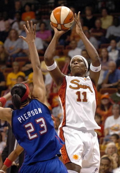 Taj McWilliams-Franklin shoots a basket over Detroit Shock's Plenette Pierson in the second half of the WNBA playoff basketball game in Uncasville Aug. 26, 2006. McWilliams-Franklin, who now plays for the Minnesota Lynx, had 18 total points as the Sun beat the Shock, 77-68.