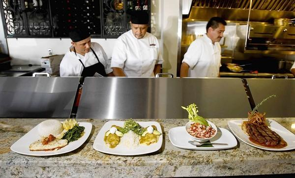 The chef and kitchen crew put out a variety of hearty dishes at the new Carmelita's in downtown Laguna.
