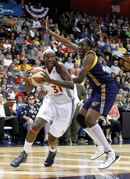 Connecticut Sun center Tina Charles (31) drives to the hoop against Indiana Fever center Jessica Davenport (50) during the second half in one of the last games of the WNBA's regular season on Sept. 19, 2012. Charles scored 17 points with 12 rebounds to help the Sun defeat the Fever 73-67 at Mohegan Sun Arena.