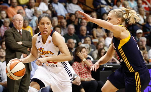 Connecticut Sun guard Kara Lawson (left) drives the hoop against Indiana Fever guard Erin Phillips (right) during the second half at Mohegan Sun Arena Sept. 19, 2012. The Sun defeated the Fever 73-67.