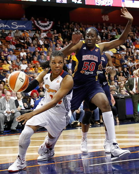 Connecticut Sun guard Tan White (14) drives to the hoop against Indiana Fever center Jessica Davenport (50) Sept. 19, 2012, during the second half at Mohegan Sun Arena. The Sun defeated the Fever 73-67.