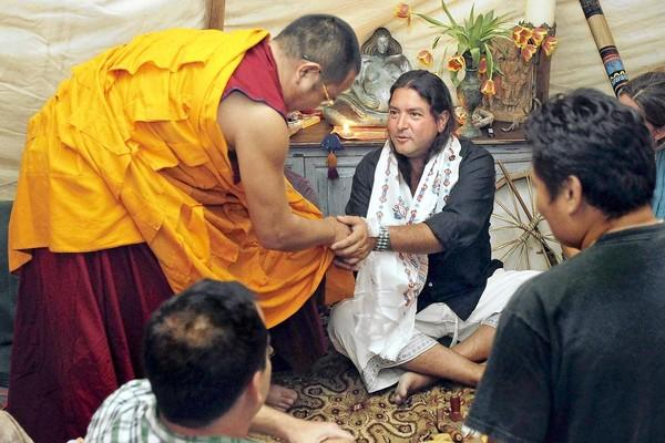 Native American Andrew Soliz, right, thanks Tibetan monk Tenphel, left, after receiving a gift at Soiz's residence in Laguna Beach on Wednesday.