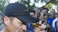 To host Lance Armstrong, triathlon drops sanctioning