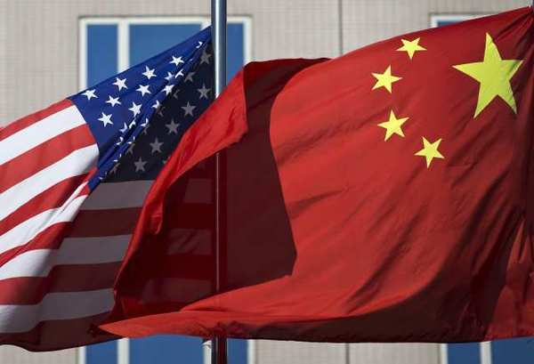 The U.S. flag and China's flag flutter in winds in Beijing during a visit to China by Secretary of State Hillary Clinton earlier this month.