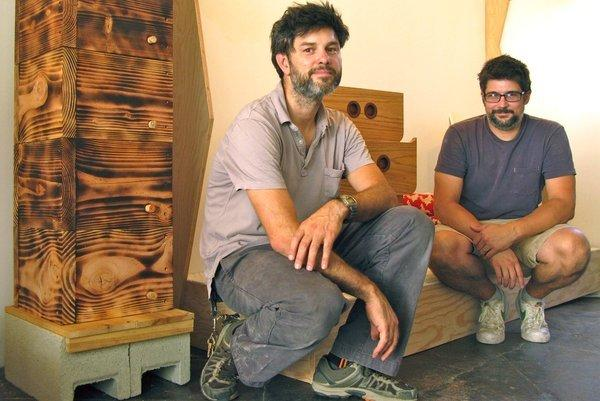 The 100XBetter stacked beehive, left, is made of Douglas fir blackened with a torch. The design duo of William Rollins, left, and Brendan Sowersby will be selling the hive for $250 and offering DIY plans as a free dowload on their site.