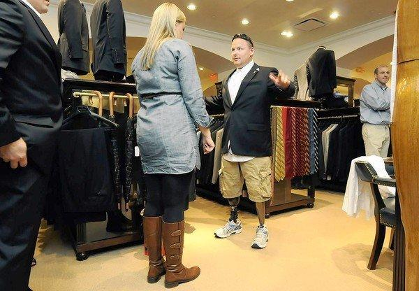 Brooks Brothers clothing store assistant manager Kathy Bartosiak helps Marine veteran Jared Luce of Coventry with a fitting for a new business suit Thursday at the West Hartford store. Luce, and 25 other veterans with disabilities recieved new suits donated by the store as part of the University of Connecticut Entrepreneurship Bootcamp for Veterans with Disabilities week long program. The progam aims to reduce unemployment amoung veterans. Nearly 16 % of CT veterans are unemployed.