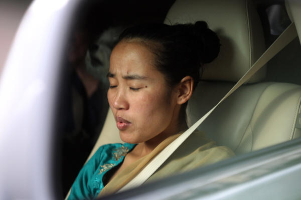 Sajina Tamang tries to calm her nerves while getting a ride from a doctor's wife to Northwestern Memorial Hospital for her pelvic and hip reconstruction surgery.