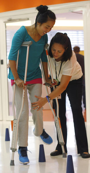 Physical therapist Nicole Williams works with Sajina Tamang at the Rehabilitation Institute of Chicago.