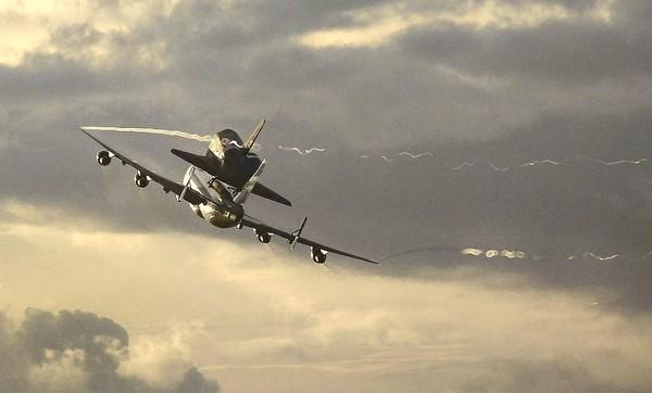 The space shuttle Endeavour ascends atop a modified Boeing 747 after taking off from Florida on Wednesday. Endeavour is scheduled to arrive in Los Angeles today.