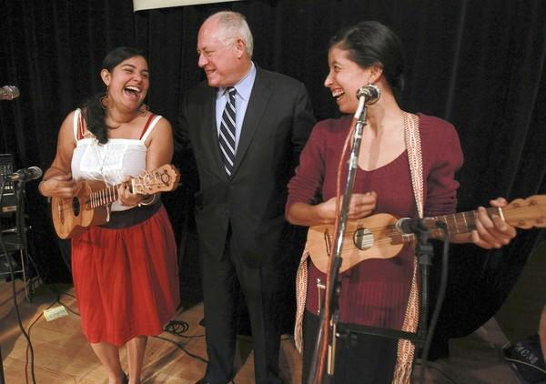 Gov. Pat Quinn greets Maya Fernandez, left, and Laura Cambron, two members of Jarochicanos, a group that played Thursday at a Hispanic Heritage Month event in Pilsen.