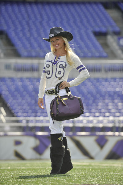 Molly Shattuck, a former Ravens cheerleader, models the Kickoff Lace-Up Tee from Touch by Alyssa Milano ($65), Little Earth cowboy hat ($29.99), Old Pro Leather's glitz belt ($79.95), Little Earth's duffel purse ($159.99) and Devotee boots by Cuce ($144.99). Makeup: Juliana Childress/Spa SEVEN. All items are available at nflshop.com.