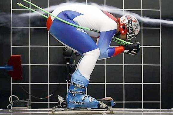 Smoke is blown into the wind tunnel as Swiss skier Silvan Zurbriggen participates in a wind test in Emmen