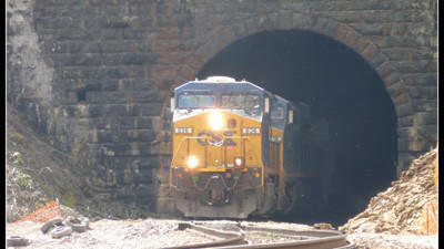 CSX train driving through the Pinkerton Tunnel