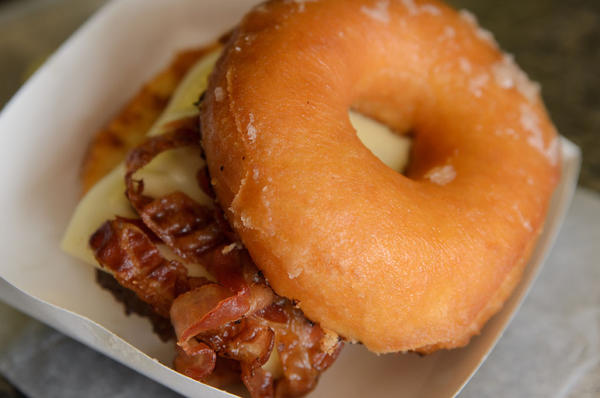 The Craz-E Burger, a cheeseburger with bacon gracing a Krispy Kreme donut.