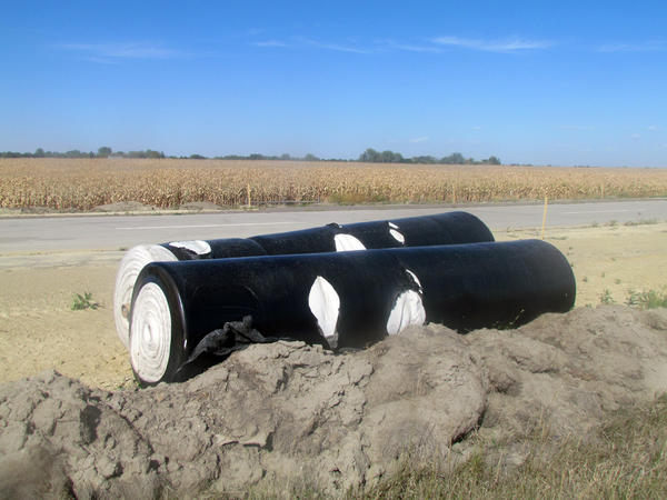 Giant black rolls of plastic are being seen along U.S. Highway 12. The rolls are actually a synthetic fiber used to help strengthen the road.