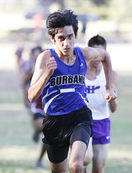 Burbank's Arsen Mkrtchyan runs hard for the finish line in fourth place at Griffith Park for a Pacific League cross country meet.