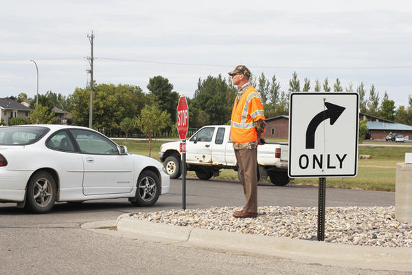 Traffic in the main parking lot at Central High School has gotten much better after the addition of islands, signs and more supervision, said school principal Jason Uttermark, seen at right.