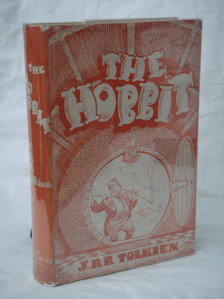 "A 1942 edition of ""The Hobbit"" for Foyles book club, directed at British children. Believe it or not, that's meant to be Bilbo Baggins in the suit. Tolkien is said to have remarked, ""Surely the paper wasted on that hideous dust-cover could have been better used."""