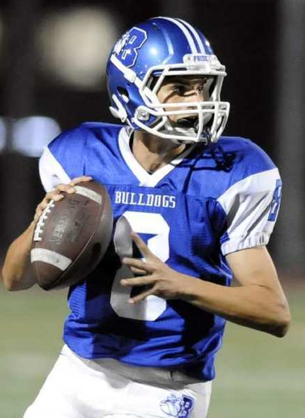 Burbank Bulldogs' quarterback Ryan Meredith looks to throw against Hoover.