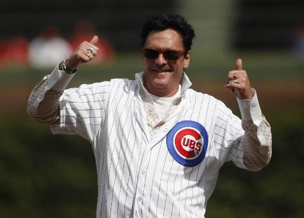 Actor Michael Madsen reacts after throwing out the first pitch before the Cubs-Reds game at Wrigley Field.