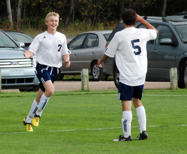 Petoskey sophomore Eric Hoffman (left) celebrates his first half goal with teammate Hunter Viles against Gaylord Thursday at the Click Road Soccer Complex. The Northmen defeated the Blue Devils, 4-1, to improve to 6-7-1 overall, 5-2 league.