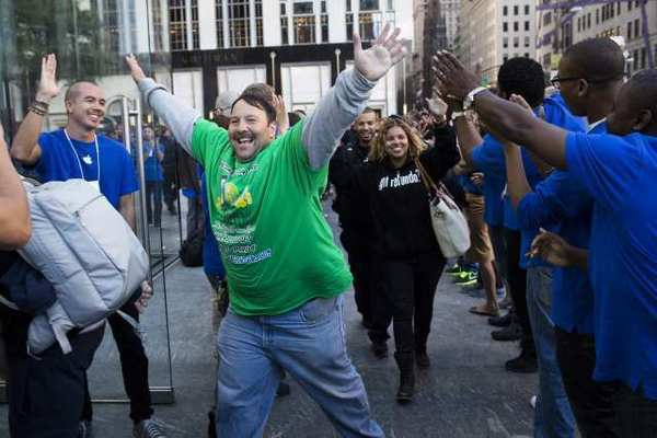Greg Packer, 49, celebrates the fact that he gets to enter the Apple store on Fifth Avenue in Manhattan, on his way to purchase an iPhone5.