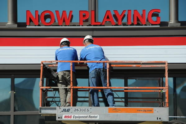 John Lampron, of Thomaston, (left) and Mike Krayeski, of Terryville, (right) secure the faces on the marquee at the Spotlight Theaters on Front Street in Hartford. The movie complex is scheduled to open in early November. Lampron and Krayeski work for Laurentano Sign Group in Terryville.
