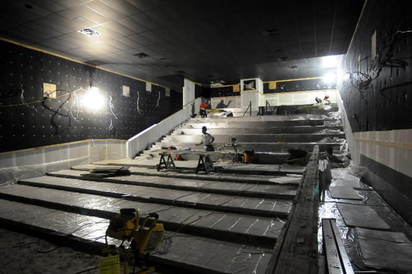 Work continues in one of the auditoriums at the new Spotlight Theaters scheduled to open on Front Street in Hartford in early November. The movie complex will house four auditoriums of varying capacity - this one will seat 230 - and will include a bar and restaurant.