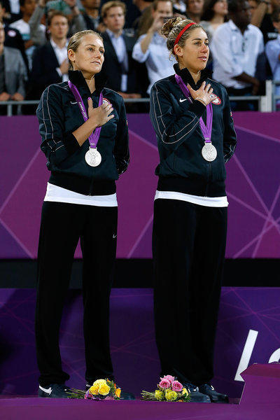 Silver medalists Jennifer Kessy and April Ross of the U.S. on the medal podium in London.