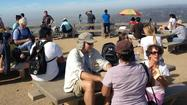 The crowd builds atop Mt. Hollywood Friday, Sept. 21.