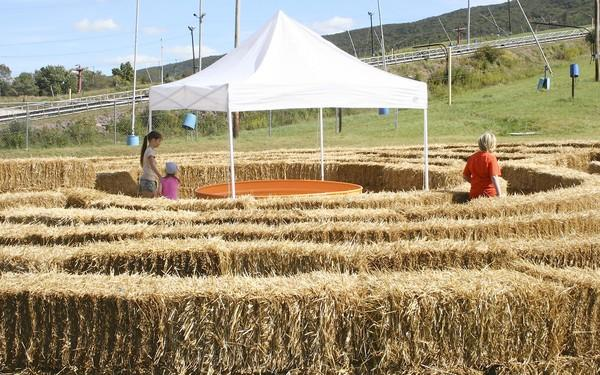 Children navigate a hay maze at the Mountain Harvest Festival at Blue Mountain