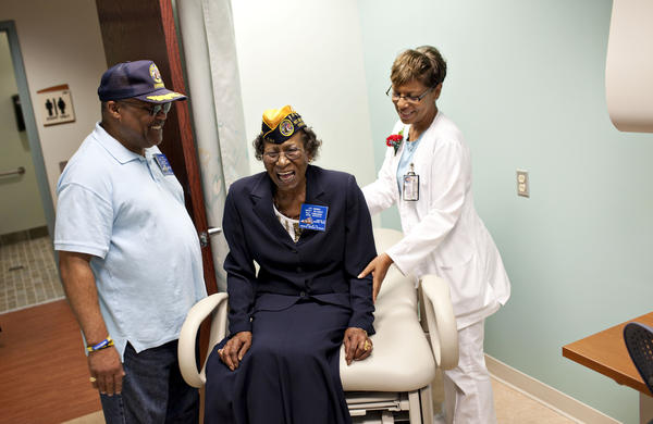 Mary Beamer, center, shares laughs with James Walton, both of Newport News and Chapter #2 Newport News of Department of VA Disabled American Veterans, as Alice Fields, right, a nurse, shows an exam room during the opening of The Hampton VA Women's Clinic on Friday. The Hampton VA Medical Center opens a 11,500 square foot Women's Clinic on the medical center campus.