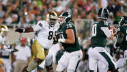 Notre Dame's Lewis-Moore won't let strain get to him