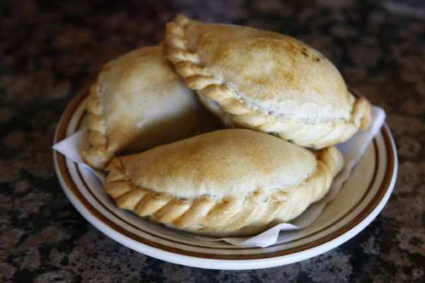 Gov. Jerry Brown signed a bill allowing sales of some homemade foods, such as non-meat empanadas, in California.