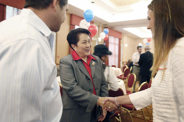 Former Glendale zoning administrator Edith Fuentes, center, is greeted by Mari Boghossian, right, and her husband, Eric, during her campaign kickoff for city council at Hilton in Glendale on Thursday, September 20, 2012.