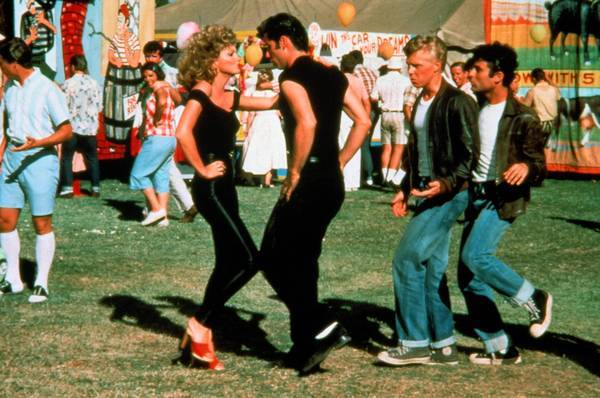 "Olivia Newton-John dances with John Travolta in the 1978 movie ""Grease."""