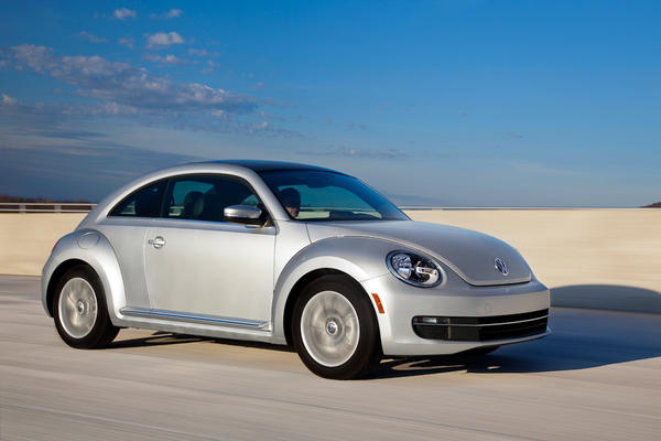 It's hard to reinterpret a classic, but VW managed by injecting a dash of Porsche into the Beetle's new design. Now lacking a bud vase on its dashboard, the car is safe for those with y-chromosomes. Base models get the Jetta's five-cylinder engine, but turbo and diesel options are offered.