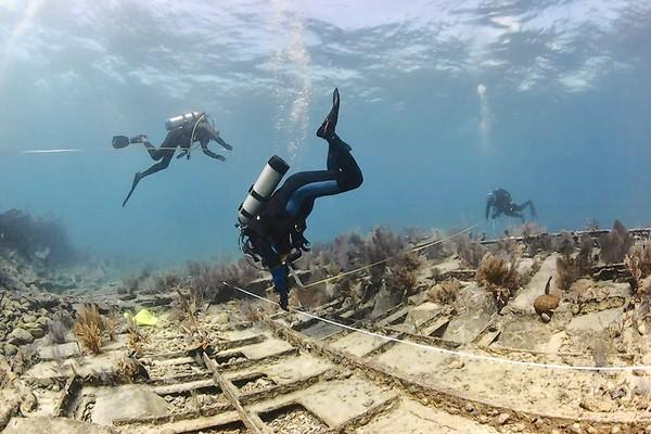 fl-mystery-wreck-tophat..NOAA science divers from the national marine sanctuary system and National Association of Black Scuba Divers are trying to confirm the identity of a shipwreck six miles off Key Largo at Elbow Reef.