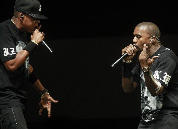 Jay-Z, left, and Kanye West, right, on stage at Staples Center December 11, 2011 for their 'Watch The Throne' tour in Los Angeles.