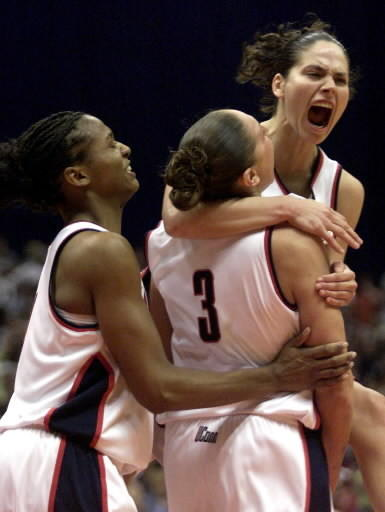 Connecticut's Asjha Jones, left, Diana Taurasi (3) and Sue Bird celebrate late in the second half against Oklahoma in UConn's 82-70 win in the NCAA Women's Final Four championship Sunday, March, 31, 2002, in San Antonio.