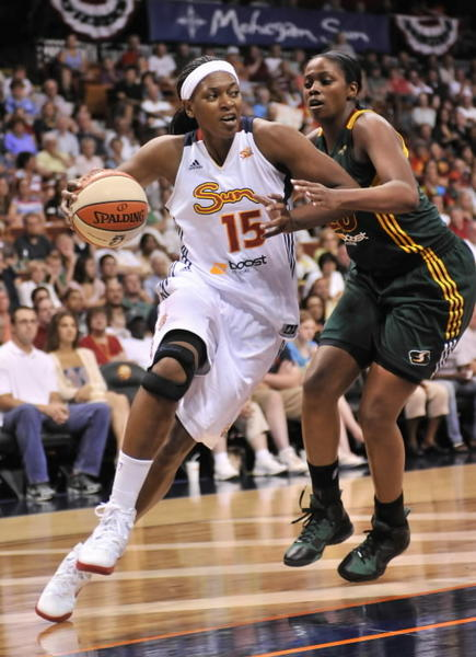 Uncasville, CT - 07/01/12: Connecticut Sun's Asjha Jones drives on Seattle Storm's Camille Little at Mohegan Sun Arena.