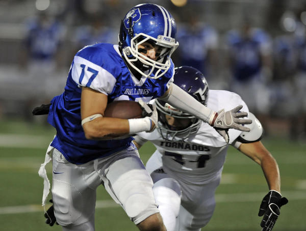 Burbank's Joseph Argenziano (17) runs the ball through coverage during the first half of their Pacific League prep football game against Hoover at Burroughs High School on Thursday, Sept. 20, 2012 in Burbank, Calif.