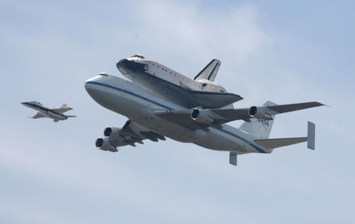 The Space Shuttle Endeavour flies over the Griffith Observatory in Los Angeles on Friday, Sept. 21, 2012.