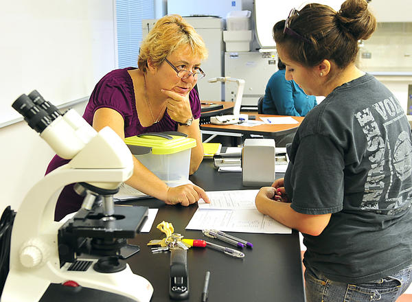 Hagerstown Community College biology professor Dr. Elaine Ashby confers with freshman Mysteree McDaniel Tuesday in STEM building bio-tech lab. The college was awarded a grant which will add equipment, including new microscopes.